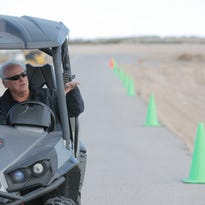 Lyle Byrum stands on what will be a hairpin turn on the state-of-the-art racetrack on the same property as the El Paso Motorplex that he currently owns.