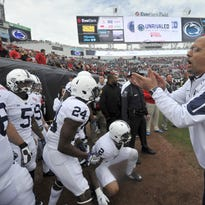 Penn State coach James Franklin leads his team onto the field before the TaxSlayer Bowl against Georgia on Jan. 2.