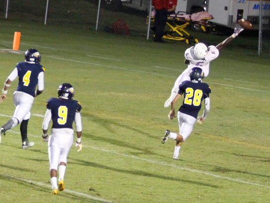 Clarksville High's J.J.Jones stretches to try to catch