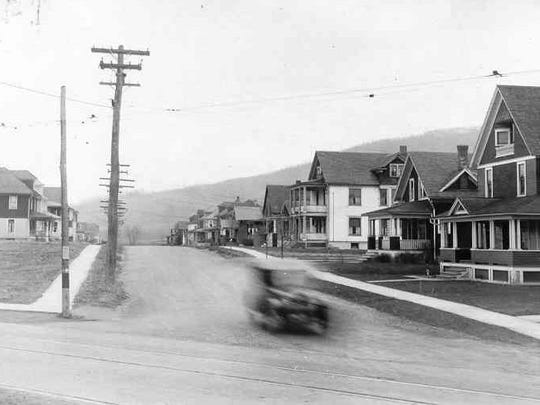 A speeding car travels along the streets of Port Dickinson, about 1935.