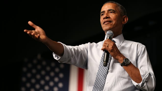 President Barack Obama speaks at North High School in  Des Moines, Iowa, Monday Sept. 14, 2015, with US Secretary of Education Arne Duncan.