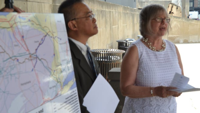 Assemblywoman Barbara Lifton, D-Ithaca, and Walter of the Ithaca-based Toxics Targeting Inc., announce in Binghamton on July 7, 2016 ab initiative to halt further fossil fuel infrastructure dervelopment in New York.