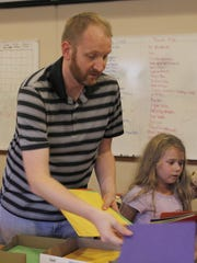 Southeast Polk school board candidate Eric Sundermeyer organizes supplies.