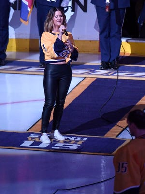 Country star Maren Morris sings the National Anthem before game 5 of the first round NHL Stanley Cup Playoffs at the Bridgestone Arena Friday, April 20, 2018, in Nashville, Tenn.