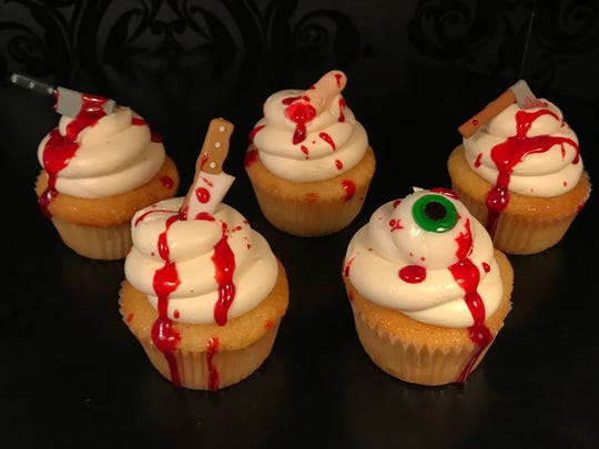 "Gory cupcakes from Sinful Sweets have a vanilla cake, vanilla buttercream and strawberry ""blood."""