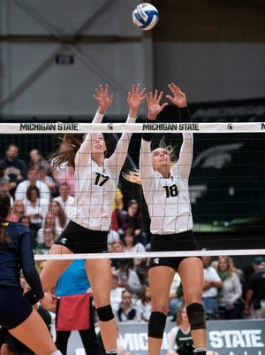 Michigan State's Alyssa Garvelink, left, had 12 kills, hit .526, and put up a match-best seven blocks in the Spartans' 3-0 win over Missouri State in the first round of the NCAA tournament.
