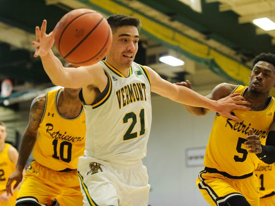Vermont's Everett Duncan (21) saves the ball from going