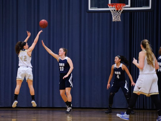 Essex's Rachel Botala (42) shoots the ball during the