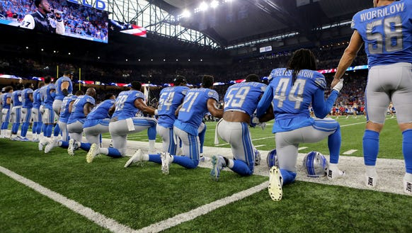 Members of  the Detroit Lions take a knee during the