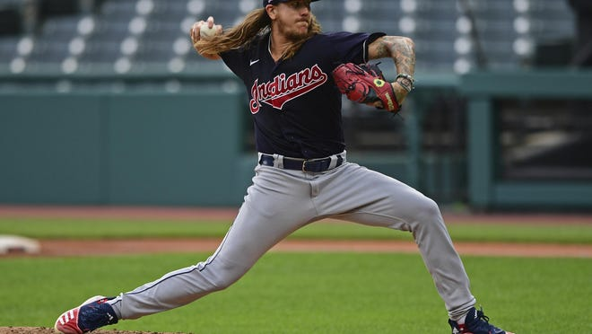 Indians starting pitcher Mike Clevinger delivers during a simulated baseball game at Progressive Field on Friday. The Indians' starting pitchers are on track to be ready to throw 100 pitches by Opening Day.