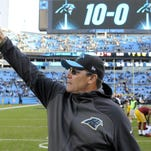 Carolina Panthers head coach Ron Rivera points to his wife in the stands after a game in Charlotte. Rivera was on the hot seat a few years ago, but team owner Jerry Richardson showed patience. Now in his fifth year, Rivera and the Panthers are headed for the Super Bowl.