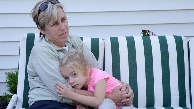 Laura Wambach and her daughter Kyler in her parents back yard.