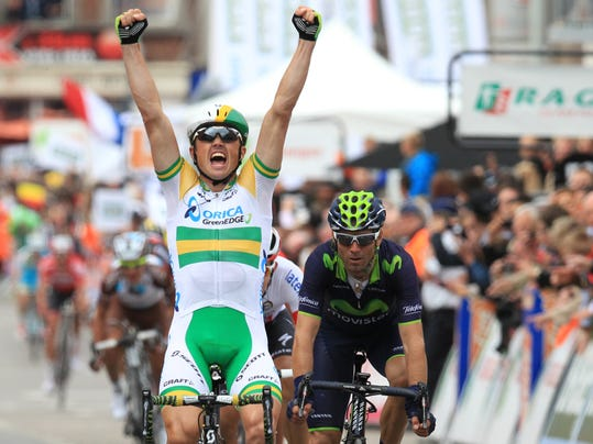 Australia's Simon Gerrans of the Orica Greenedge team celebrates as he wins the 100th edition of the Belgian cycling classic and UCI World Tour race Liege-Bastogne-Liege, in Ans, Belgium, Sunday, April 27, 2014. Spain's Alejandro Valverde of the Movistar team came second, followed by Poland's Michal Kwiatowski of the Omega Pharma Quickstep team who placed third. (AP Photo/Yves Logghe)