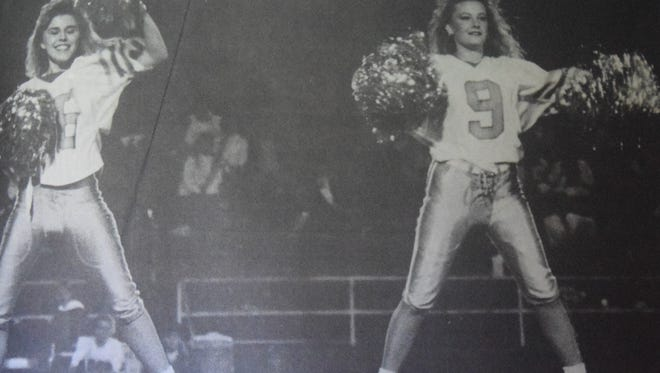 Jennifer Trowbridge and Laura Espy perform as members of the UCHS drill team in October of 1991.