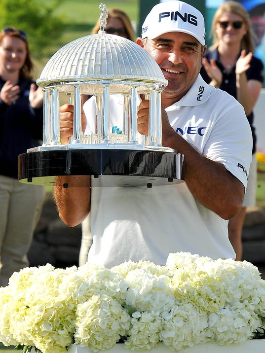 Angel Cabrera holds up The Greenbrier Classic Springhouse Trophy after winning the Greenbrier Classic golf tournament at the Greenbrier Resort in White Sulphur Springs, W.Va., Sunday, July 6, 2014.  (AP Photo/Chris Tilley)