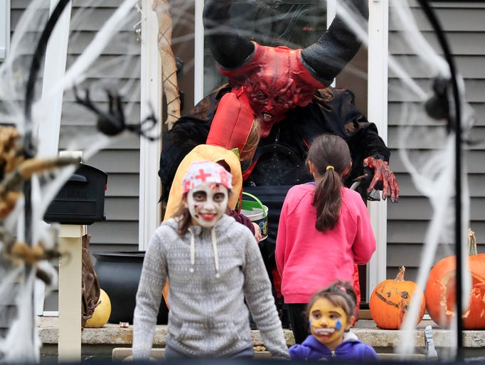 Trick-or-treaters go in search of candy on Tuesday,