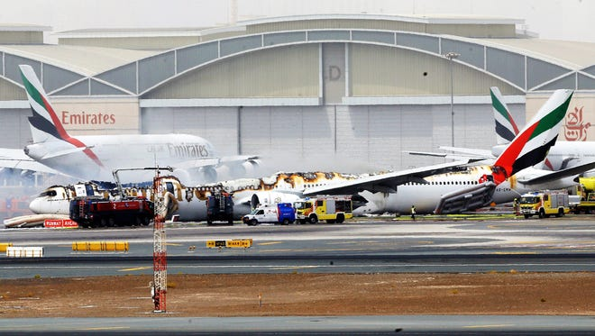 An Emirates Airlines Boeing 777 from Trivandrum to Dubai lays on the ground in Dubai airport after being gutted by fire at Dubai International Airport.