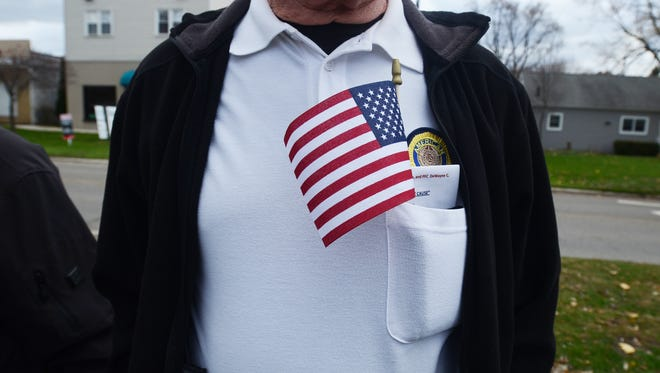 Jerry Westrick, of St. Clair, keeps his American flag tucked in his shirt pocket, Sunday, Nov 10, during a Veteran's Day ceremony.