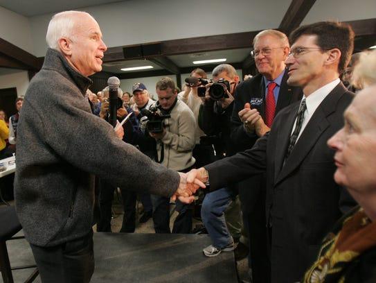 Republican presidential hopeful Sen. John McCain greets
