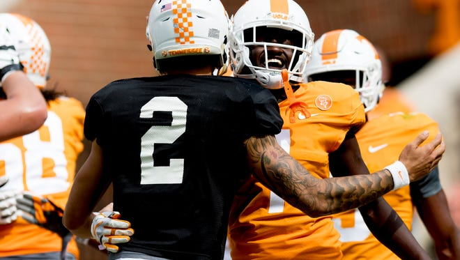 Tennessee wide receiver Brandon Johnson (7) celebrates a touchdown with Tennessee quarterback Jarrett Guarantano (2) during the Tennessee Volunteers Orange & White spring game at Neyland Stadium in Knoxville, Tennessee on Saturday, April 21, 2018.