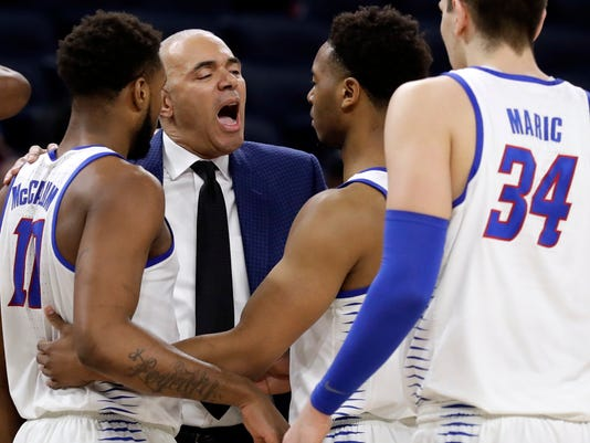 DePaul coach Dave Leitao talks to his team during the second half of an NCAA college basketball game against Creighton, Wednesday, Feb. 7, 2018, in Chicago. Creighton won 76-75. (AP Photo/Nam Y. Huh)