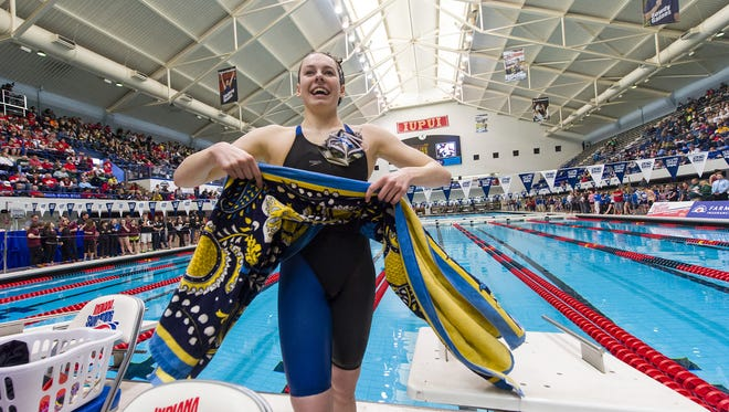 Carmel High School's Claire Adams leaves the pool after competing in the 200 Yard Freestyle event of the 2013-14 IHSAA Girls Swimming and Diving State Championships Saturday, Feb. 15, 2014, at Indiana University Natatorium in Indianapolis.