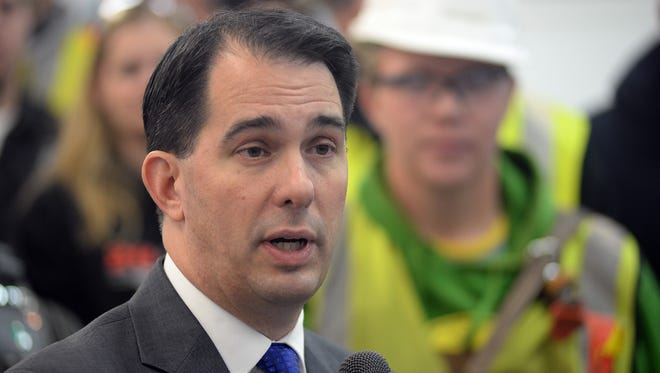 Gov. Scott Walker speaks in front of a group of students at Northeast Wisconsin Technical College in Green Bay last November.