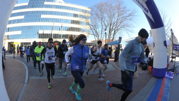 Nearly 100 volunteers and runners braved a chilling morning in the shadow of the Jackson Building to benefit The Arc of Buncombe County, and organization which assists individuals with moderate to severe intellectual disabilities.