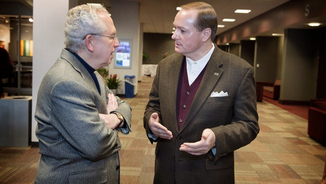 Mississippi State President Mark Keenum (right) speaks with SEC Commissioner Mike Slive. Keenum was voted as the league's vice president on Friday.
