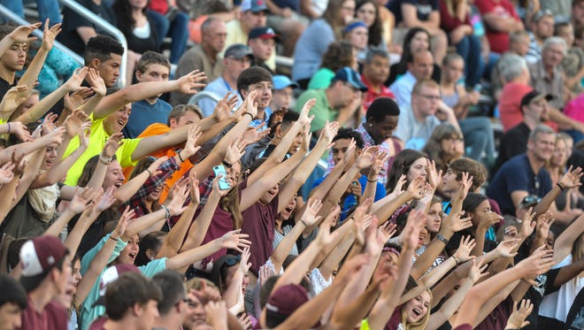 Owen fans cheer on the Warhorses Friday night in Swannanoa.