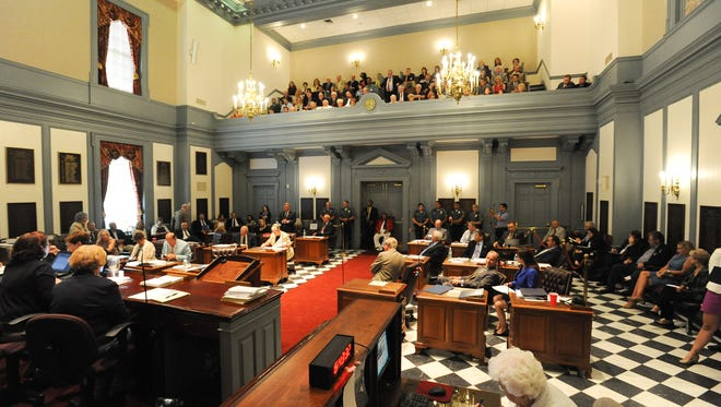 More than a dozen political aides in Legislative Hall received raises between 5.6 percent and 16.6 percent in January and July of this year, even as lawmakers reduced and eliminated general pay increases for rank-and-file state employees, The News Journal reported on Tuesday.