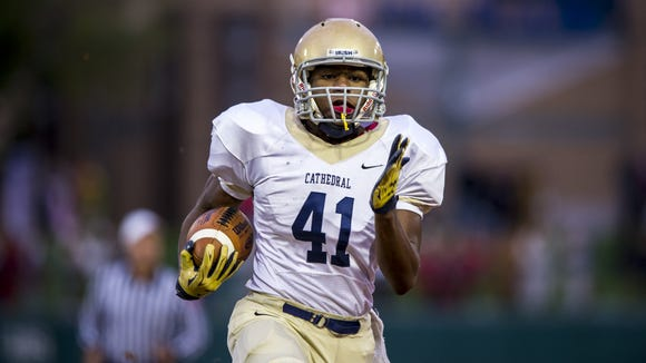 Cathedral High School sophomore Markese Stepp (41) runs the ball out of the backfield and into the end zone to score during the first half of action of an inaugural IHSAA varsity football game being played at Victory Field in Indianapolis, Friday, October 2, 2015.