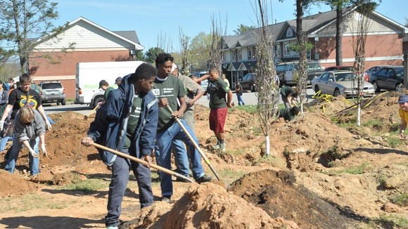 Volunteers work in the  Hillcrest in April, sponsored by Asheville Greenworks and TD Bank.