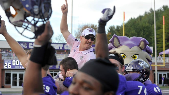 Mark Speir (center) has Western Carolina in contention for the Southern Conference football title.