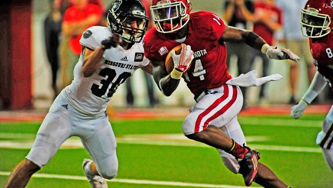 USD's Michael Frederick heads in for a touchdown past Jared Beshore of Missouri State in an Oct. 24 game at the DakotaDome.