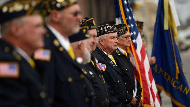 Veterans from Robinson American Legion Post #538 Carlton during a Veterans Day ceremony outside The Cannery in downtown Green Bay on Wednesday, Nov. 11, 2015.