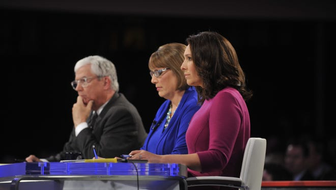 From left, Kevin Cooney, Kathie Obradovich and Nancy Cordes moderate the CBS News Democratic Presidential Debate at Drake University on Saturday.