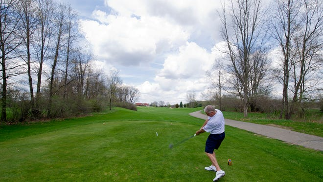 In this 2014 photo, Binder Park Golf Course PGA professional and general manager Ron Osborne tees off with a driver on the par-4 No. 9 hole on the Preserve Course at Binder Park.