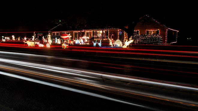 Christmas decorations and traffic patterns make a light trail on Blooming Grove Road on Dec. 1, 2015.