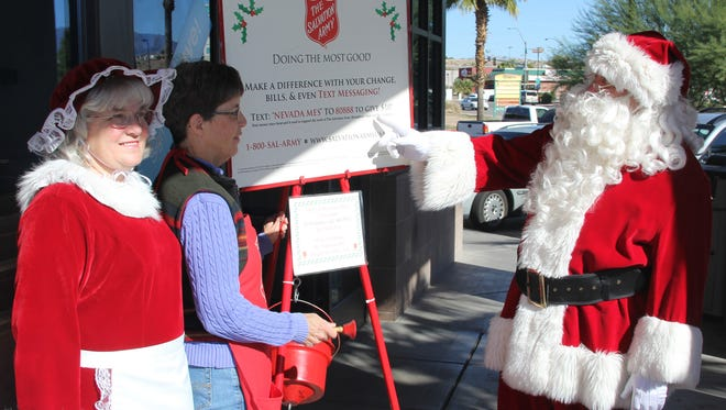 Mrs. Clause and Santa support Mesquite Salvation Army volunteer Polly Struhar.