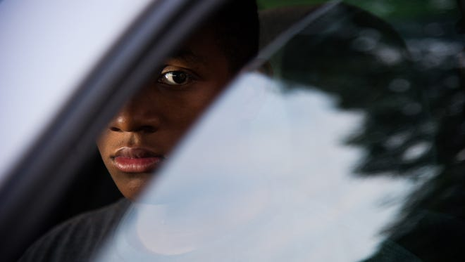 Brian Powers/The Register John Hawkins Jr., 18, of Des Moines was stopped by Des Moines police in April. He was questioned and then allowed to leave. He received no warning or citation and said he wasn?t told why he was stopped. His parents believe it was racial profiling. Police later said officers were investigating break-ins that involved a car similar to the one he was driving, and the stop was for a nonworking brake light. One evening in late April, John Hawkins, 18 of Des Moines, was returning home when he was stopped by DMPD. He was asked for his license, registration, insurance. Police asked him where he was going, what he'd been doing, what his plans were for the rest of the night. Then he was allowed to leave. This stop happened on Hickman near 38th  Street. Here he poses for a portrait Wednesday, June 3, 2015. Brian Powers/The Register