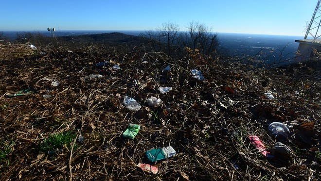 The overlook from Tower Road on top of Paris Mountain is covered with trash and graffiti.