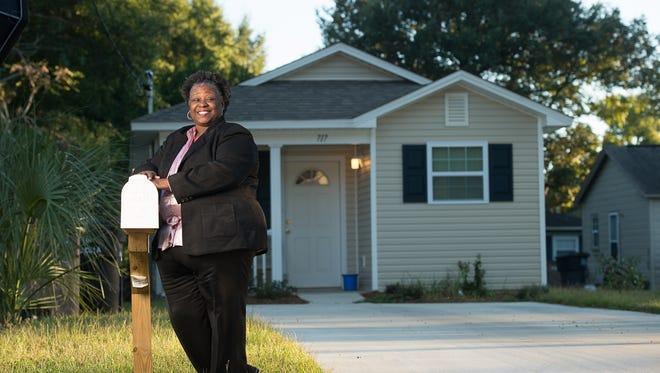 Sharon Nixon at her Habitat home in Pensacola  Oct. 18, 2015.(Michael Spooneybarger/ Studer Community Institute)