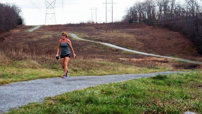 A walker explores Rocky Ridge park Dec. 27.
