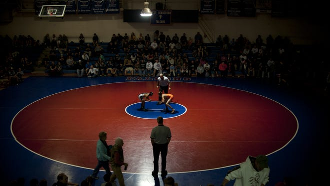 West Henderson hosts the Falcon Frenzy wrestling tournament each season. The Falcons will hold a 20-year reunion for their 1996 state-championship team on Friday.