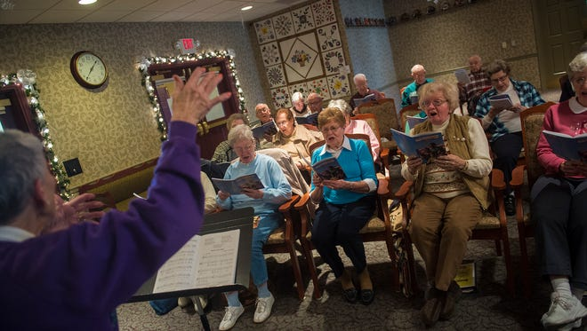 Conductor Ann Settle leads the Joyful Singers group in a community sing-along at Homewood at Plum Creek, a retirement home in Hanover, on Jan. 11.