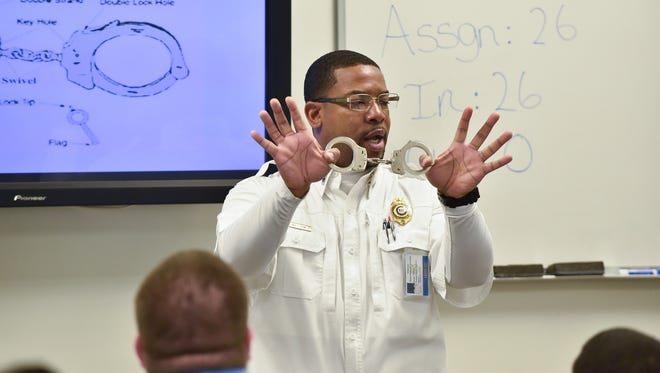 Staff Lieutenant Bernell Williams with the Delaware Department of Correction teaches a class the proper techniques for handcuffing a prisoner in the Correctional Employee Initial Training in Dover.