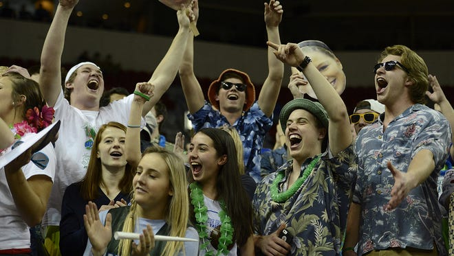 Green Bay Notre Dame's student section celebrates during at the Resch Center during the 2014 WIAA state girls basketball tournament. The WIAA's sports reference guide about defining appropriate chants has come under scrutiny in the past week.