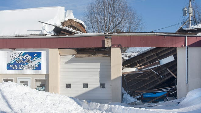The weight of the snow damaged businesses in Dallastown Sunday.