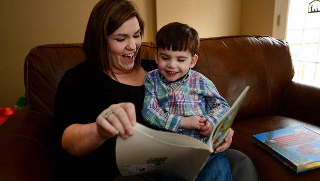 Landyn Clark, 4 and his mother Mackenzie read a book together on Thursday.